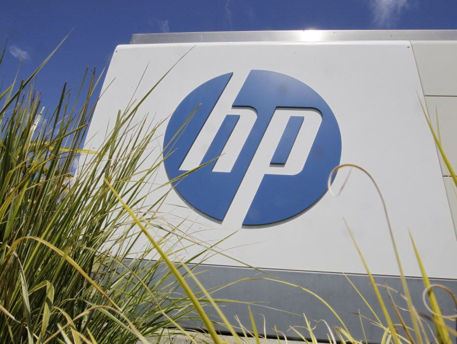 FILE - In this Aug. 21, 2012, file photo, the Hewlett-Packard Co. logo is seen outside the company's headquarters in Palo Alto, Calif. Hewlett-Packard Co. is splitting itself into two companies, one focused on its personal computer and printing busin