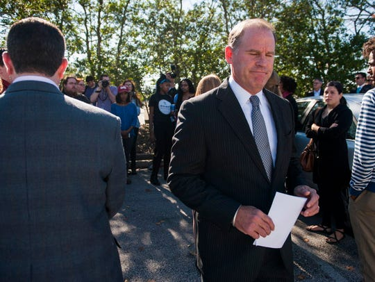 University of Missouri President Tim Wolfe walks away