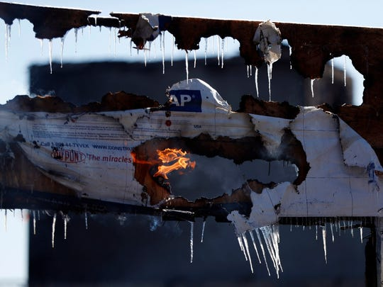 Flames and icicles on a construction frame at the site of the AvalonBay apartment complex under development in Maplewood, which was damaged by fire on Feb. 4.