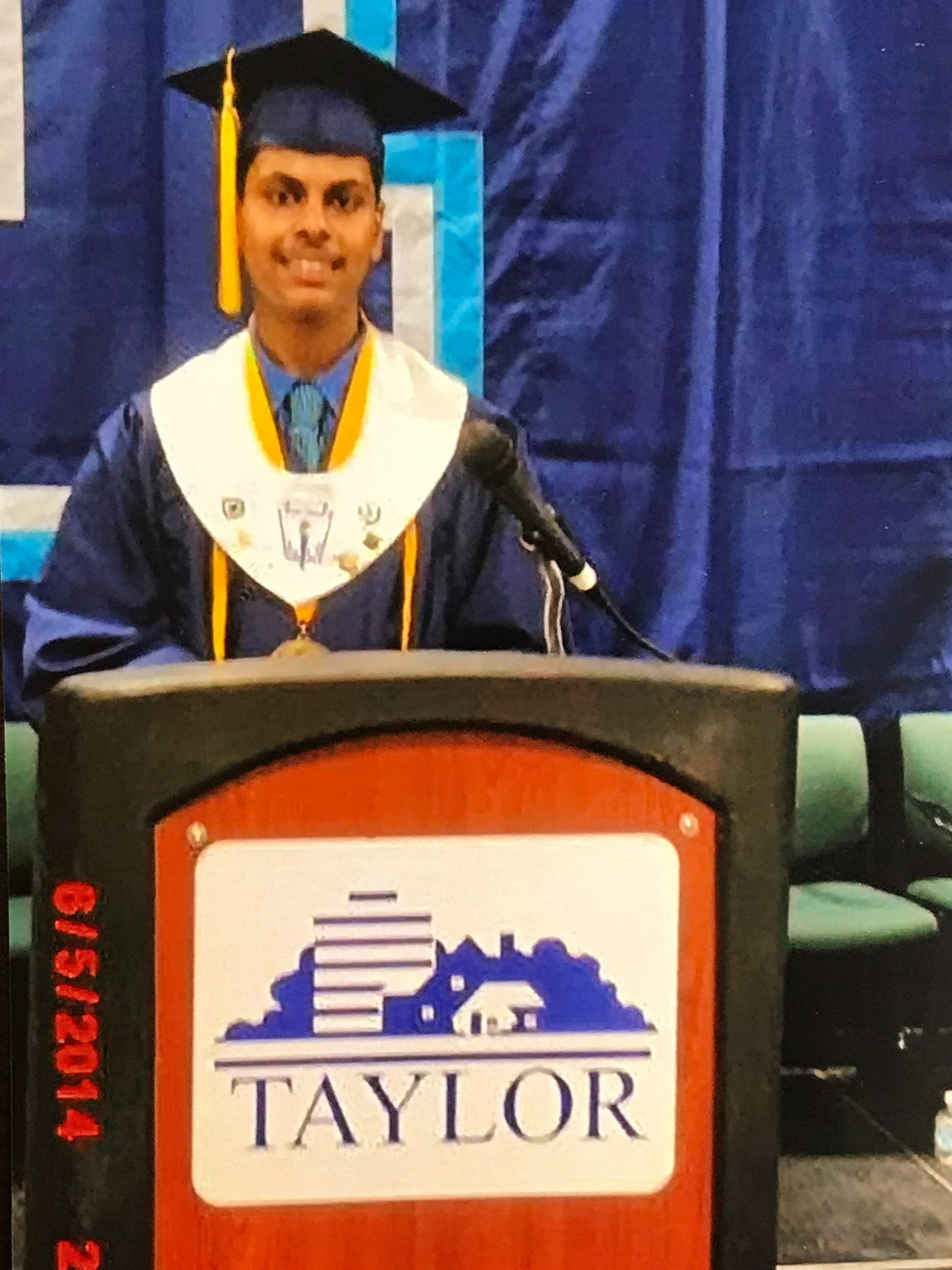 This is a family photo from the high school graduation of Raheel Siddiqui.