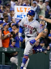 New York Mets' Brandon Nimmo smiles as he rounds the