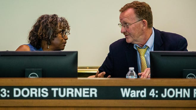 Ward 3 Ald. Doris Turner, left, talks with Ward 7 Ald. Joe McMenamin, right during a recess of the Springfield City Council as they try to decide on a winner of the Ward 2 election between Shawn Gregory and Gail Simpson during a special meeting of the Springfield City Council, Thursday, July 18, 2019, in Springfield, Ill.