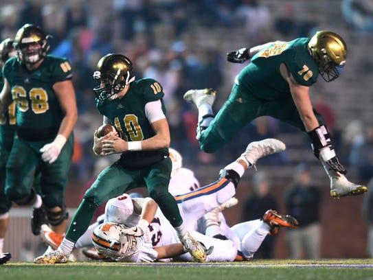 Knoxville Catholic's Jack Sompayrac (10) runs the ball