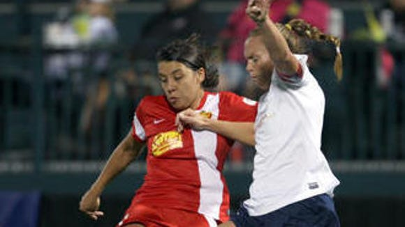 Flash forward Sam Kerr, left, won the team's Golden Boot this season with nine goals. Here she's doing battle with NWSL Best XI defender Christie Rampone of Sky Blue FC.