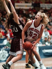 ISU's Janel Grimm powers up against Texas A&M's Kim Linder and scores inside. Grimm, a former player for Montezuma, was one of the most prolific scoreres in Iowa High School Girls Baskeball history.