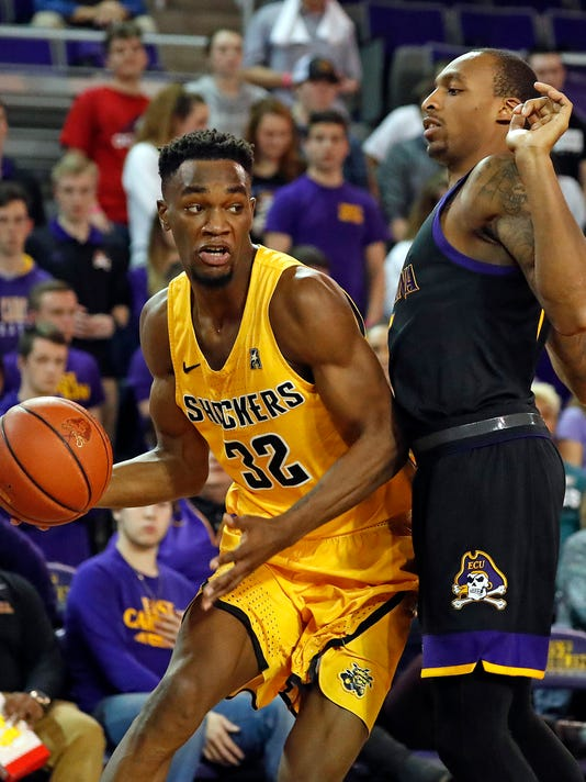 Wichita State's Markis McDuffie (32) drives the ball around East Carolina's Kentrell Barkley (15) during the second half of an NCAA college basketball game in Greenville, N.C., Thursday, Jan. 11, 2018. (AP Photo/Karl B DeBlaker)