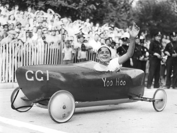 Billy White, the 1941 Detroit Soap Box champion, waves