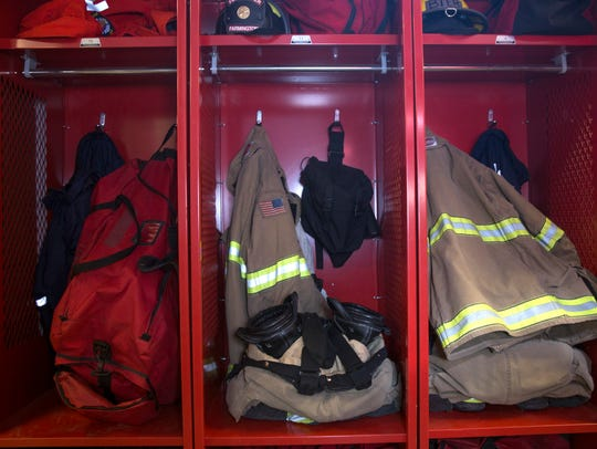 Protective firefighting gear is stored in a locker area on Thursday at Farmington Fire Department Station One in Farmington.