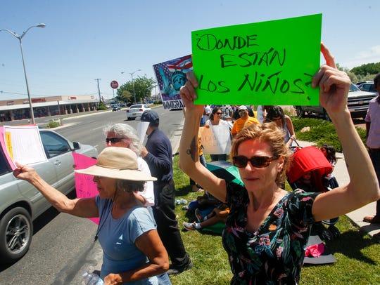 "Erica Love, of Farmington, holds a sign asking ""Where"