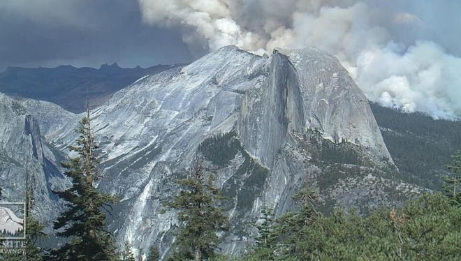 Screen shot of of the Yosemite Conservancy's Web camera shows the meadow wild fire in the distance.