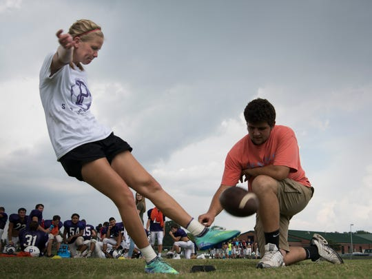 Camrin Lyle practices her field goal kicks with Jacob