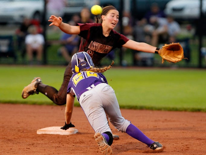 Male High School's Haley Simon (22) dives in to second base ahead off the tag by Assumption High School's Alyssa Tarquinio (8) in the girls 7th Region High School Softball final at Ulmer Stadium in Louisville, Kentucky, May 30, 2014.