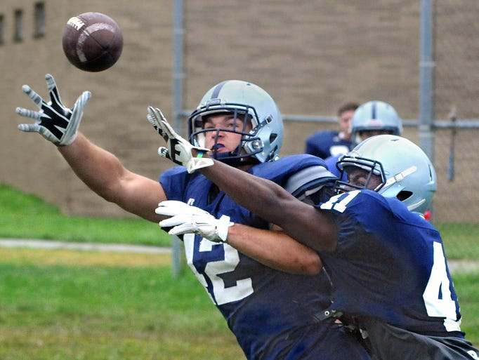 John Jay High School receiver Robbie Schumacher, left, attempts to catch a pass while being covered by Josh Barr during football practice Friday in Wiccopee.