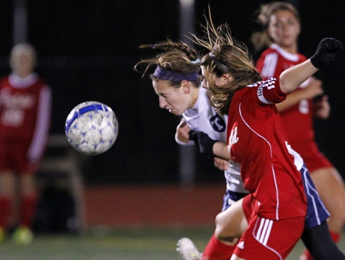 Jenna Valleriano, left, gets her head on a ball vs. Penfield's Jamie Forken.