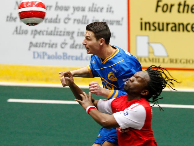 Rochester's Troy Cole, left, heads a ball against Missouri's Stefan St. Louis during MISL soccer action between the Missouri Comets and the Rochester Lancers at the Blue Cross Arena in Rochester on Jan. 1, 2014.