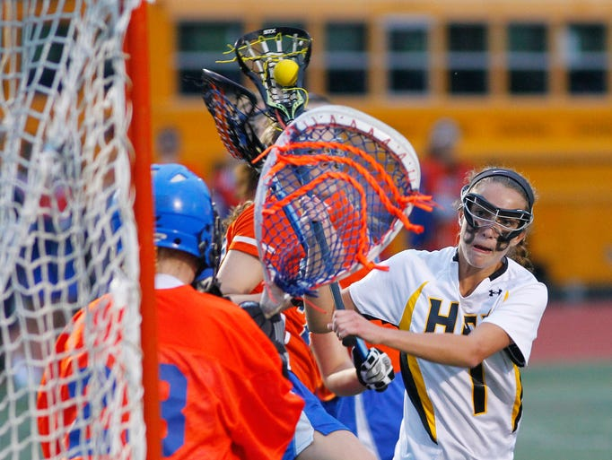 HF-L's Brittany Chamberlain, right, scores a Cougar goal past Penn Yan's Jessica Covell during the Section V Class C Championship.