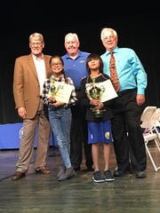 From left to right are Dr. Paul Beaty of the Palm Desert Optimist Club, Desert Sands Unified School District Spelling Bee runner-up Mia Garcia, school board member Donald Griffith, spelling bee winner Jaeden Tolete, and Gary Tomak, president of the board of education.