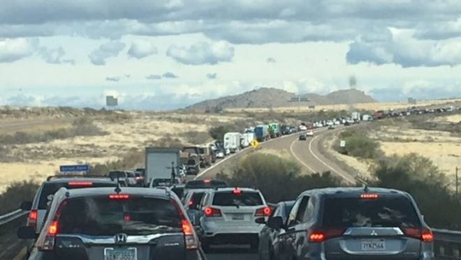 Traffic was backed up for miles after a single-vehicle rollover near Sunset Point on March 12, 2018.