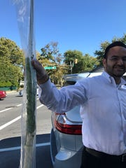 Mo Miz, 34 of Deal, holds a Lulav for Succot on Oct. 4, 2017.