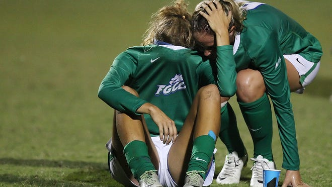FGCU's Shannen Wacker, left, is comforted by Shea Rhoney after losing to Auburn in the first round of the NCAA Soccer Championship on Saturday at the FGCU in Fort Myers.
