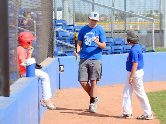 Carlsbad first baseman Will Fiala gives advice during batting drills Tuesday at Bob Forrest Youth Sports Complex.