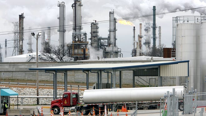 Tanker trucks refill at the Valero Refinery facility at Rivergate Industrial Port in south Memphis .