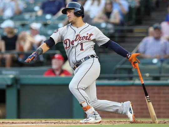 Tigers shortstop Jose Iglesias hits an RBI double in