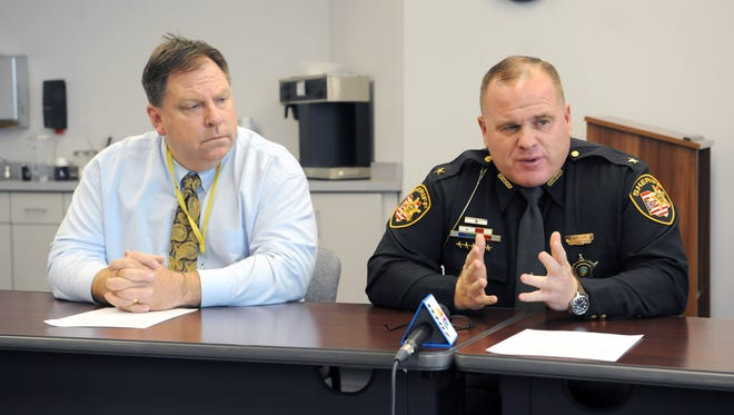 From left, Monte Bainter, Maysville Local School District superintendent, Muskingum County Sheriff Matt Lutz and Ric Roush, Maysville Local School District safety director (not pictured), hold a press conference Thursday in response to a non-immediate, non-specific threat found by the Maysville district. Additional safety measures will be instituted at the schools, including an increased law enforcement presence.
