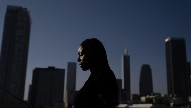 HOLD FOR STORY BY SOPHIA TAREEN Efuru Flowers, A co-founder of Black Women Rally for Action, poses for photos Monday, Sept. 28, 2020, in Los Angeles.