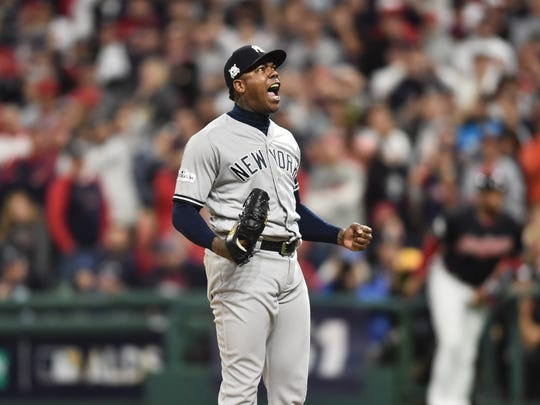 Yankees relief pitcher Aroldis Chapman celebrates after defeating the Cleveland Indians during game five of the 2017 ALDS playoff baseball series at Progressive Field.