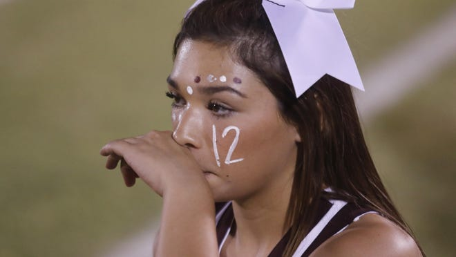 Ralls cheerleader Lorna Faber, 17, wears a number 12 on her cheek along with the rest of the cheerleaders to honor Ralls football player Ryan Soliz during the Jackrabbits' season opener against Farwell on Friday Ralls. Soliz, who wore te number as a junior varsity player, was killed in a vehicle accident on April 20 in Crosby County.