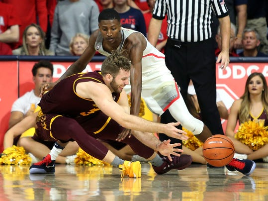 Arizona State forward Mickey Mitchell, left, releases the ball as Arizona guard Dylan Smith watches during the second half of an NCAA college basketball game Saturday, Dec. 30, 2017, in Tucson, Ariz. (AP Photo/Ralph Freso)