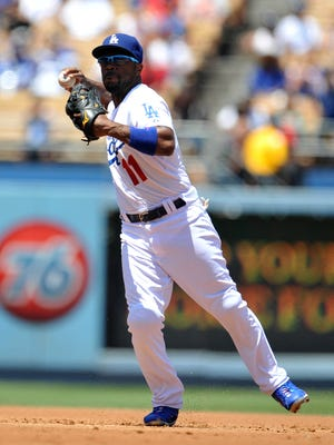 Dodgers shortstop Jimmy Rollins throws to first to complete an out in the second inning Saturday against Los Angeles Angels at Dodger Stadium.