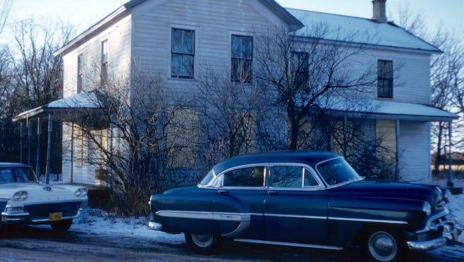 """Slide box marked """"Decoration Day, Wausau 1957, Schiltz 6-57, Gein's House"""""""