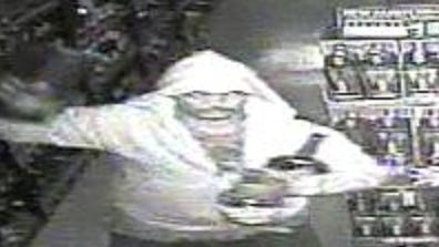 State police are seeking tips to identify this man, shown from surveillance video as he burglarized a liquor store near Georgetown early Monday.