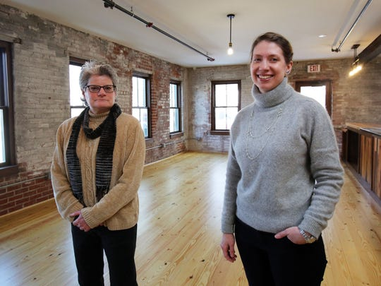 Mary Linge, director of the real estate development for Hudson River Housing, left, and Elizabeth Druback-Celaya, the director of organizational and community development, at the Poughkeepsie Underwear Factory Feb. 13, 2017. The former factory is being redeveloped as a mixed use building by the Hudson River Housing.