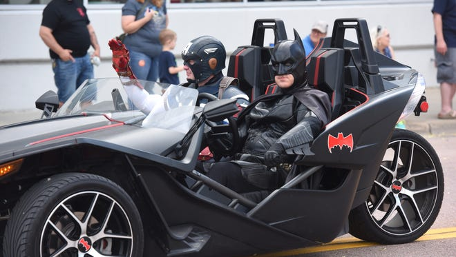 Batman and Captain America attend the Independence Day celebration in downtown Sioux Falls, S.D. Wednesday, July 4, 2018.