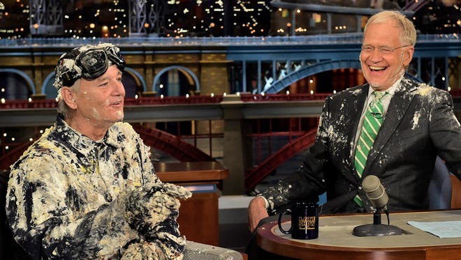 """After emerging from a cake, Bill Murray chats with David Letterman on Tuesday's episode of """"Late Show."""""""