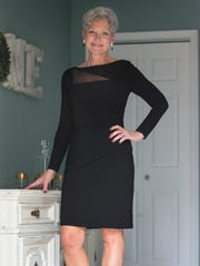 Anna Touchard wears a sheath dress with black mesh inset by Ralph Lauren with Style & Co. heels.