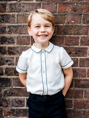 Britain's Prince George poses for a picture following the christening of his brother Prince Louis, at Clarence House in London. His parents, Prince William and Duchess Kate released the photo to celebrate his fifth birthday.