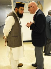 St. Mary's Parish Center in Manahawkin hosted an interfaith group of religious leaders from the Muslim, Jewish and Christian communities for a dialogue about cultural diversity and respect on Wednesday evening. Interfaith coordinator, Joe Costantino (right), greets Iman Maqsood Ahmed Quadri of The Islamic Center of Ocean County (left) at the event.