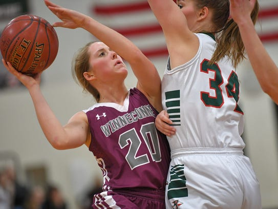 Abby Gilman (20) of Winneconne goes up for a shot against Bailey Sternitske (34) of Berlin on Jan. 12 in Berlin.