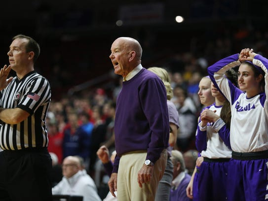 Indianola coach Bert Hanson talks to a referee during the Class 5A state basketball quarterfinal game on Feb. 26.