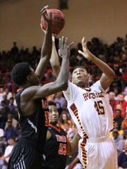 Humboldt's Anthony Jones (45) goes up for a shot against