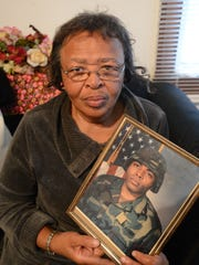 Wanda Turner of Nanticoke holds a photo of her son, Wardell Turner, who was killed in Afghanistan in November. Turner will be buried in Arlington National Cemetery in January.