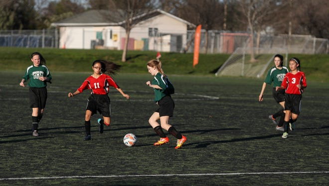 Junior high school players from Parsons and Boulder Creek schools compete in a match Friday at the California Soccer Park. Soccer and city officials are hoping to replace the worn turf using a combination of community donations and matching grants.