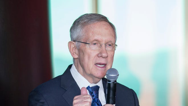 Senator Harry Reid speaks before the revealing of the world's largest rooftop solar array in Las Vegas on Oct. 27.