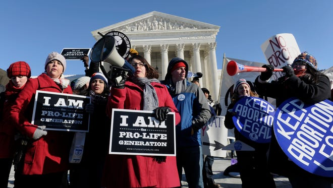 Opponents and supporters of abortion rights rally outside the Supreme Court in Washington during the recent March for Life.