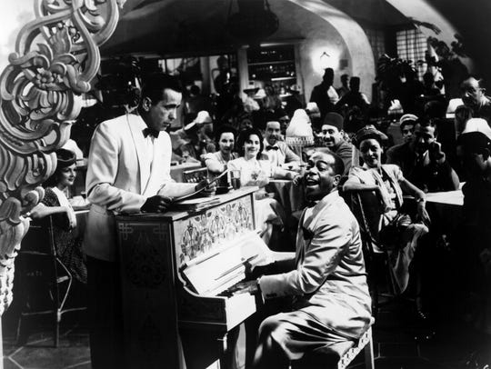 Rick (Humphrey Bogart, left) listens to piano player