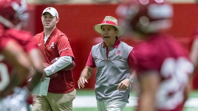 Alabama coach Nick Saban works his defensive backs through drills during the NCAA college football team's spring practice Tuesday, March 20, 2018, in Tuscaloosa, Ala. (Vasha Hunt/AL.com via AP)